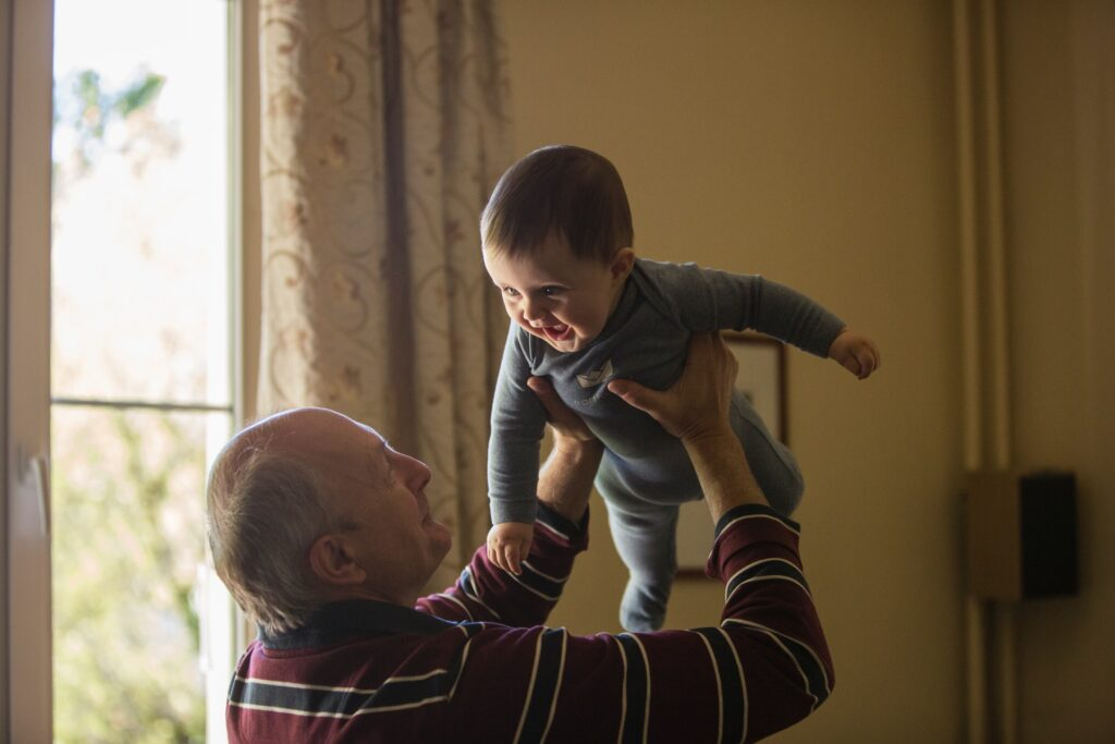 Grandparent with grandchild.